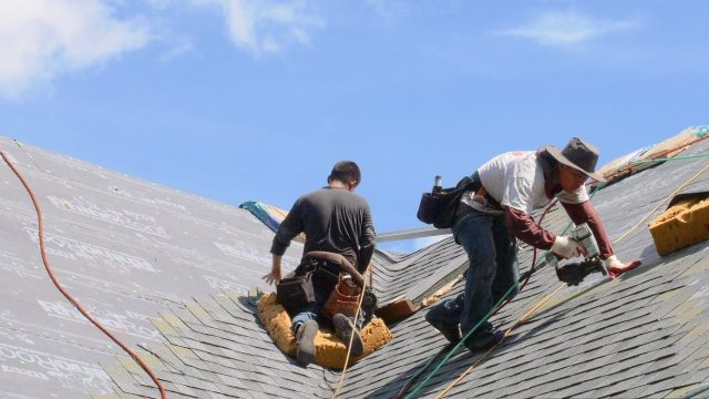roofer in Detroit MI working on a roofing project
